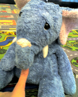 Blue Sad Eyed Elephant with Tusks