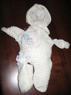 , FOUND – SLEEPING? DOLL Wearing RIBBED SLEEPER with ABC on Chest
