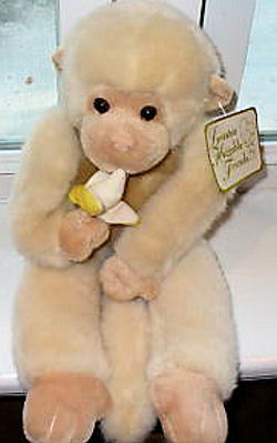 Claw Machine Champagne Monkey Holding a Banana in Both Hands