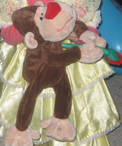 Brown Monkey with Red Nose Holding a Rose