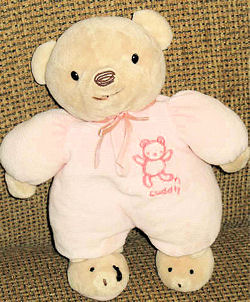 Carter's Brown Bear wearing a Pink Sleeper and Bear Slippers