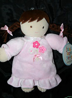 Carter's Just One Year Bond Doll wearing a Pink Dress with Flowers