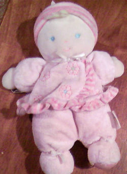 Carter's Brown Hair Doll wearing a Pink Flower Dress and a Hat