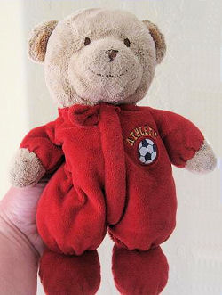 Carter's Brown Bear wearing a Red Sleeper with a Soccer Ball and Athletic on the Chest