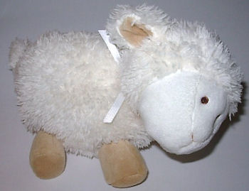 , FOUND – Carter's White Tan Lamb Pink Polka Dot Bow on Ear with Sideways Head