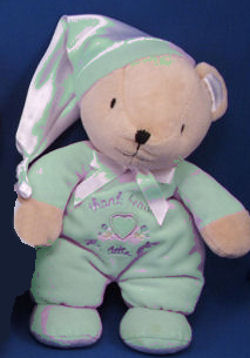 Carter's Thank Heaven for Little Babies Bear wearing a Green Sleeper with Matching Satin Stocking Cap
