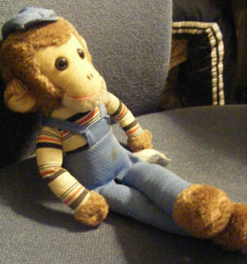Curious George? Monkey with Engineer Cap, Overalls, and Striped Shirt