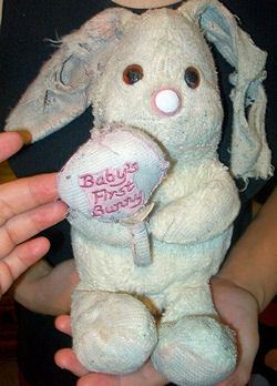 80's DAKIN Pink & White Rabbit Holding Rattle with Baby's First Bunny on it