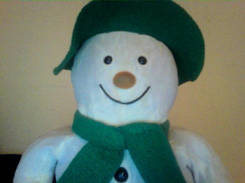 Eden Raymond Briggs Snowman, Wearing a Green Floppy Felt? Hat and Fringed Scarf