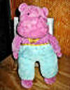 Eden Purple, Teal, and Pink Hippo, wearing a Pink and Yellow Polka Dot Tie
