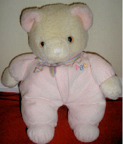 Eden White Bear wearing a Pink Sleeper with ABC on the Chest