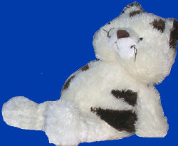 white plush cat with dark brown stripes on his back