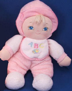 , FOUND – Goldberger BLOND DOLL Wearing PINK with ABC'S & BUTTERFLY on BIB