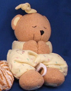 Kids II Brown Chenille Praying Bear Crib Pull Brahms Wearing Yellow Print Sleeper