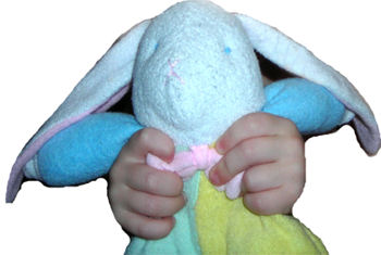 Soft Dreams Multi-Color Pastel Rabbit with an X Nose, wearing Bunny Slippers
