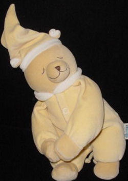 Noukie Bear wearing a Yellow Sleeper and Stocking Cap