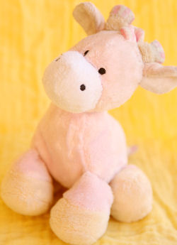 Small Pink Giraffe with Striped Mane, Tail, & Horns