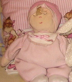 Eden Sleeping Doll Wearing Pink Thermal with a Bib