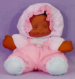 Puffalump African American Doll Wearing a Pink & Polka Dot Outfit and Pink Ruffled Bonnet