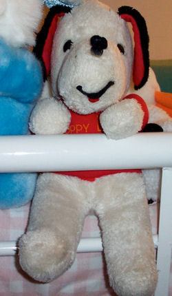 80's Puppy Love White Dog with Black & Red Ears Wearing a Red Sweater