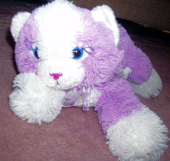 Lying Down Purple Cat with a White Face, Ears, Tummy, Feet, Tail, and a Purple Sparkly Nose