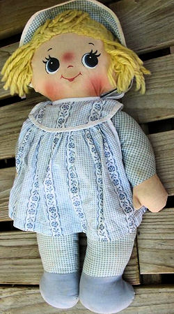 60's yellow haired musical cloth doll