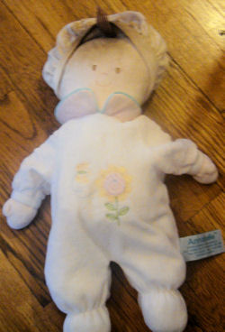 RUSS Annabelle Doll Wearing a White Sleeper with a Flower and a Butterfly on her Chest