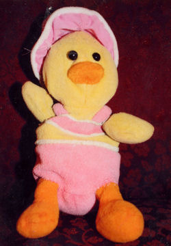 Small Yellow Duck Wearing Pink Outfit & Hat with Black Eyes