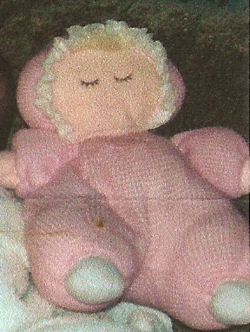 Kids Preferred? Blond Sleeping Doll wearing Pink Thermal Sleeper