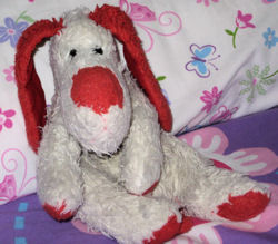 White Dog with Big Red Nose, Paws, Long Ears, and Tail