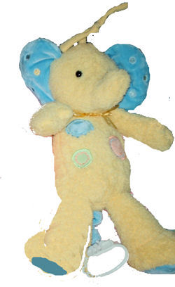 Carter's Yellow Elephant with Spots & Blue Ears Plays Music
